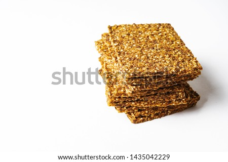 Flat lay of Stack of super-Useful rye multi-grain whole-grain crackers with different seeds on isolated background with space for text. superfoods healthy organic products.