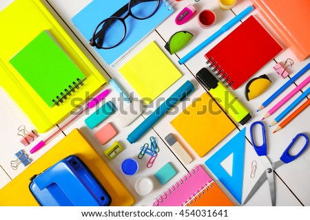 Flat lay of stationery on white wooden table background