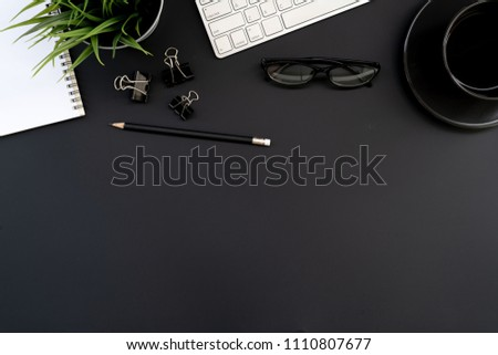 Flat lay of top view modern black desk work table with computer laptop and stationary in home office includes copyspace for add text or graphic #1110807677