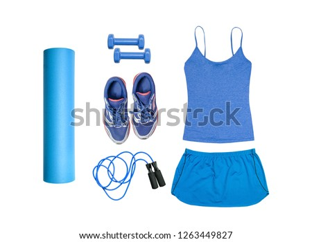 Flat lay on white background of dumbbell, sport t-shirt, jump rope, sneakers, sport equipments, fitness items, top view.