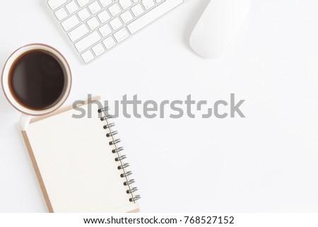 Flat lay photo of office desk with mouse and keyboard,Copy space on white background with coffee,Top view