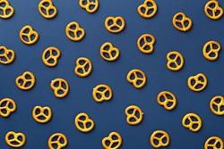Flat lay pretzels pattern on blue background