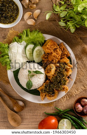 Flat Lay Shoot A Set of green chili fried squid with indonesian Spicies or A set of 'Cumi Goreng Sambal Hijau '. Cumi Goreng Sambal Hijau is Indonesian cuisine.           Stock fotó ©