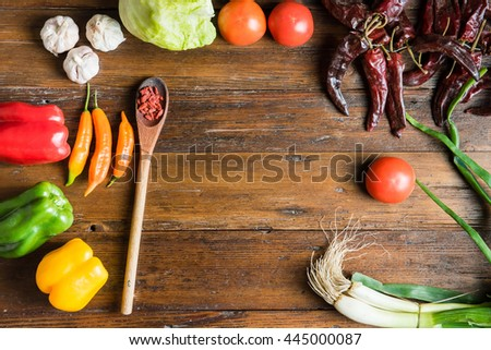 Flat lay shot of a wooden table full of raw vegetables and healthy food ready to be prepared. #445000087