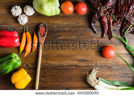 Flat lay shot of a wooden table full of raw vegetables and healthy food ready to be prepared. #445000090