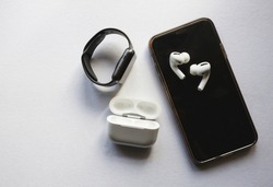Flat lay shot of gadgets and mobile devices in white background.