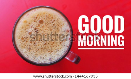 Flat lay shot of Teh tarik, the famous Malaysian tea, onred background with word - GOOD MORNING.