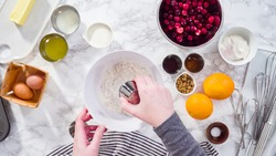 Flat lay. Step by step. Mixing ingredients in a mixing bowl to bake cranberry muffins.