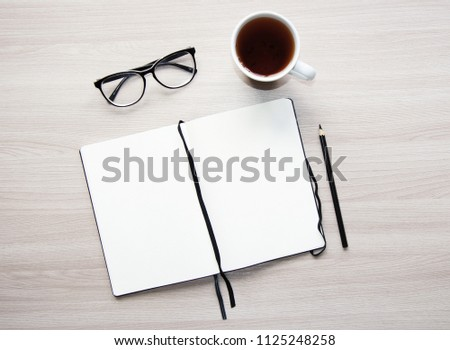 Flat lay stylish mockup photo with a blank notebook and a pencil on the light wooden background. Stock photo for blog and website.