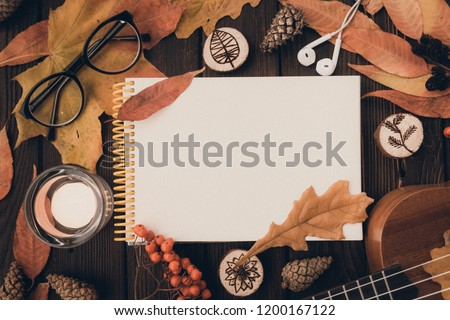 Flat lay. Textured. Autumn leaves,candles on wooden background . Autumn or Winter concept. autumn layout on the wooden table with space for an inscription with glasses falling cones #1200167122