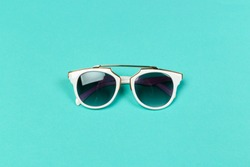 Flat lay. Top view. Fashion sunglasses on pastel background
