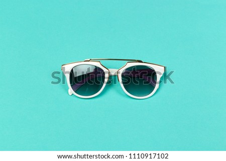 Flat lay. Top view. Fashion sunglasses on pastel background #1110917102