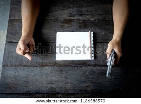 Flat lay. Top View. Journal of the police or the culprit is planning something., Illegal or intimidating businesses, bad guys, bad guys and bad plans.