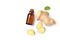 Flat lay (top view) of Ginger essential oil extract with  rhizome and slices on white background.