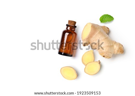 Flat lay (top view) of Ginger essential oil extract with  rhizome and slices on white background. Foto d'archivio ©