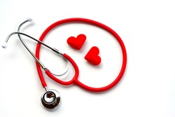 Flat lay, top view of red medical stethoscope and red hearts on white background using for healthcare, medical, treatment, education and Valentine concept.