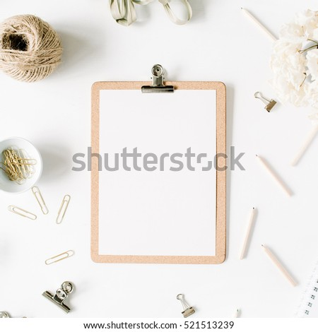 Flat lay, top view office table desk. feminine desk workspace mock up with clipboard, twine, pencils, floral bouquet, craft diary and clips on white background.