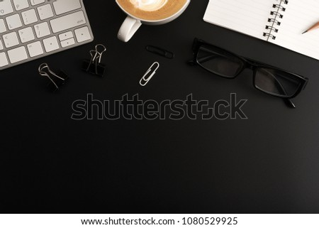 Flat lay, top view office table desk. Workspace with blank note book, keyboard, office supplies  and coffee cup on black background. #1080529925