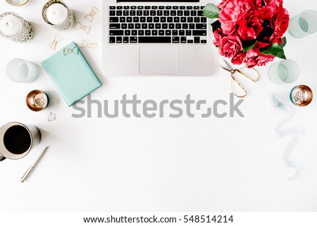 Flat lay, top view office table desk. Workspace with laptop, red roses bouquet, mint diary, coffee mug and golden scissors on white background. #548514214