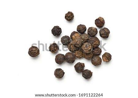 Flat lay (Top view) pile of Black peppercorns (Black pepper) isolated on white background. Stock photo ©