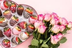 Flat lay. Variety of chocolate dipped strawberries in a heart-shaped box.
