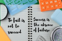 Flat lay view of magnifying glass, alphabet shape, calculator, earphone box, compass, ruler and memo note with quote 'To fail is not to succeed' and 'Success is the absence of failure'.