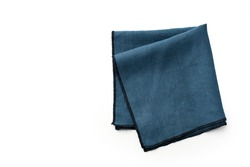 Flat lay with blue linen kitchen napkin isolated on white background. Folded cloth for mockup with copy space, top view
