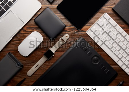 flat lay with different devices on wooden workplace #1223604364