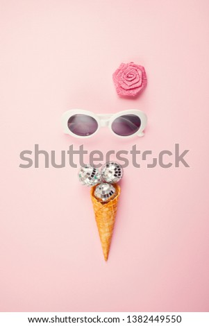 Flat lay with disco balls in the ice cream cone and girl sunglasses. Party, celebration, summertime concept #1382449550