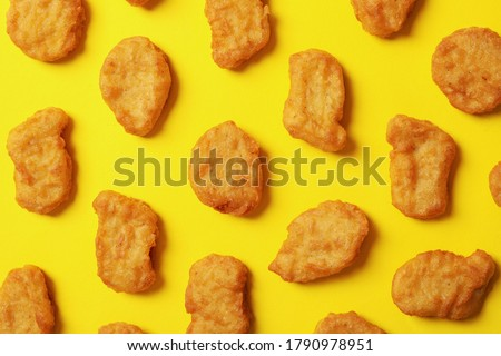 Flat lay with fried chicken nuggets on yellow background Сток-фото ©