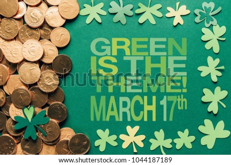 flat lay with golden coins and green is the theme, march 17th lettering on green background