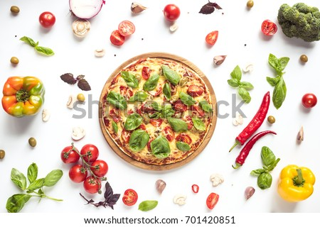 flat lay with italian pizza on wooden board and various ingredients isolated on white