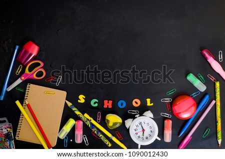 Flat lay with lettering back to school and set of school equipment on blackboard #1090012430