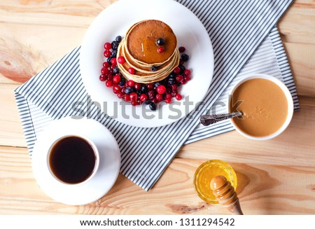 Flat  lay with pancakes, honey, peanut paste and coffee. #1311294542