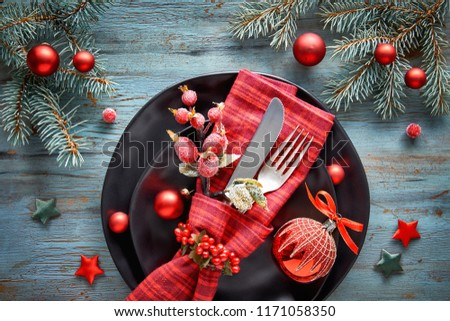 Flat lay with Xmas decorations in green and red with frosted berries, trinkets, plates and crockery, Christmas menu concept #1171058350