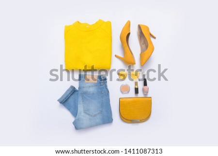Flat lay women fashion clothes and accessories, with cosmetics