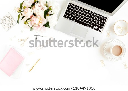 Flat lay women's office desk. Female workspace with laptop, pink peonies bouquet, accessories on white background. Top view feminine background. #1104491318