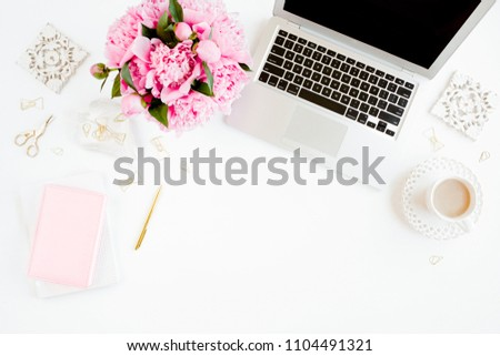 Flat lay women's office desk. Female workspace with laptop, pink peonies bouquet, accessories on white background. Top view feminine background. #1104491321