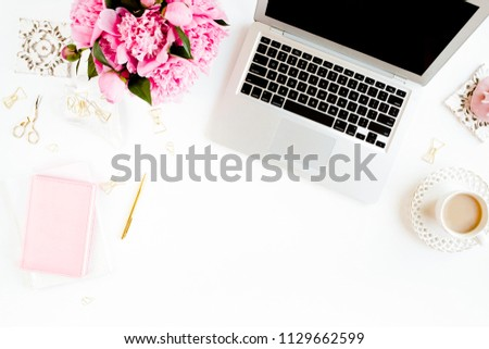 Flat lay women's office desk. Female workspace with laptop, pink peonies bouquet, accessories on white background. Top view feminine background. #1129662599