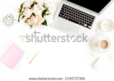 Flat lay women's office desk. Female workspace with laptop, pink peonies bouquet, accessories on white background. Top view feminine background. #1134737306