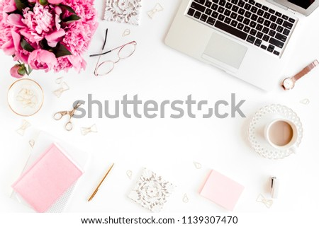 Flat lay women's office desk. Female workspace with laptop, pink peonies bouquet, accessories on white background. Top view feminine background. #1139307470