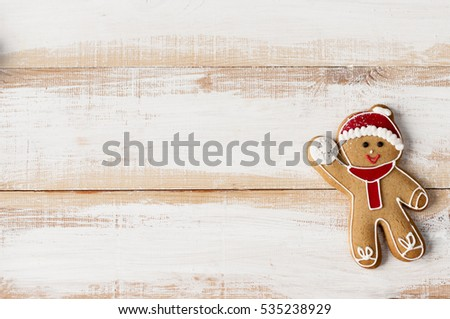 Flat lay xmas gingerbread man  on wooden boards.