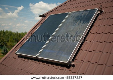 Flat-plate solar collector on roof in summer