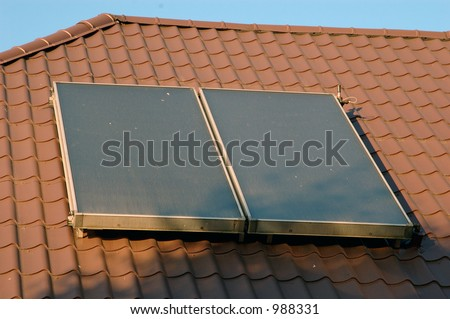 Flat-plate solar collector on the roof.