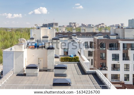 Flat roof with air conditioners on top modern apartment house building exterior mixed-use urban multi-family residential district area development. Сток-фото ©