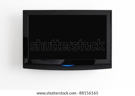Flat screen LCD hanging at the wall with clipping path for the screen