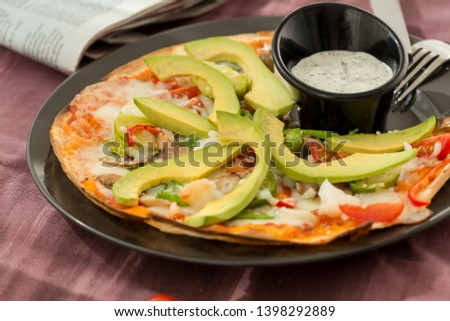 flat thin gourmet pizza, gourmet pizza, homemade sliced top view and olive oil
