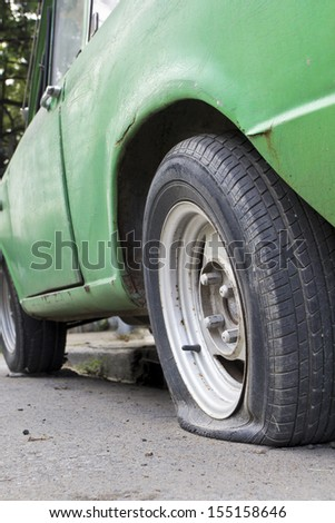 Flat tire of old car