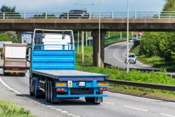 flatbed lorry truck on uk motorway in fast motion
