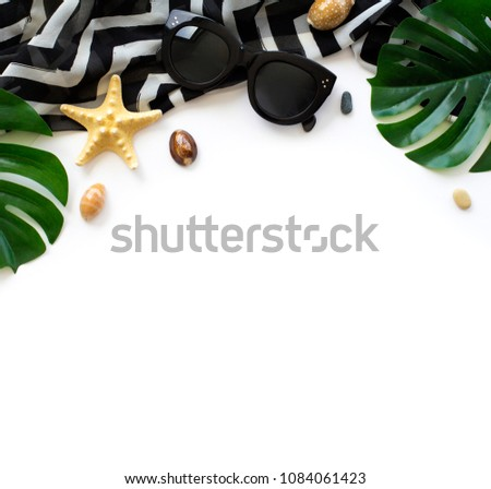 Flatlay beach accessories on white background. Top view travel or vacation concept. Summer background. #1084061423